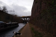 Canal, railway and road above