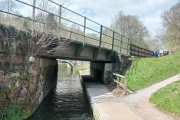 The canal goes under the low railway bridge