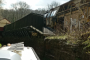 The platform overhangs the canal