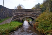 A roving bridge - takes the towpath from one side to the other