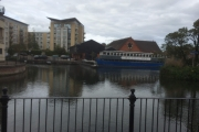 NB Sanguine dwarfed by the party boat in Reading!